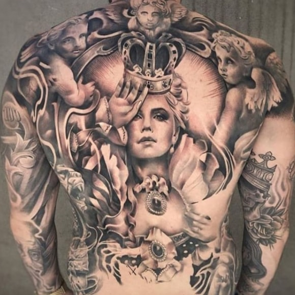 girl with a crown tattoo on his back