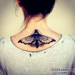 Black and white detailed mole butterfly tattoo on upper back _42