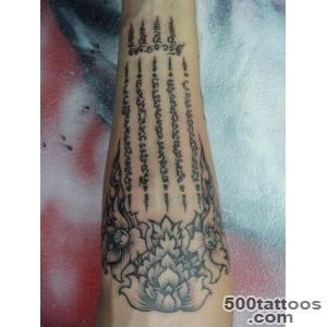 Wonderful Flowers With Muay Thai Bamboo Style Tattoo On Forearm_38